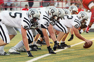 The football team gets into position during the Aug. 30 varsity game at Kimbrough Stadium.