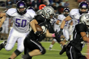 Junior Wyatt Garton drives for a TD at Randall's Oct. 11 game against Canyon.