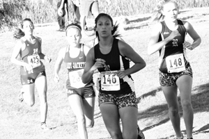 Senior Denise Altamirano runs during a cross country meet.