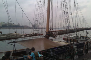The group loads the sailboat for their two hour ride to the Statue of Liberty and Ellis Island. Shortly after, a storm hit New York causing a quick and wet return to shore.