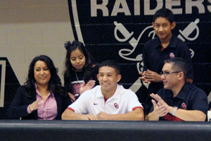 Senior Jacob Rubio signs to wrestle for the University of Oklahoma Nov. 20 in the west gymnasium.