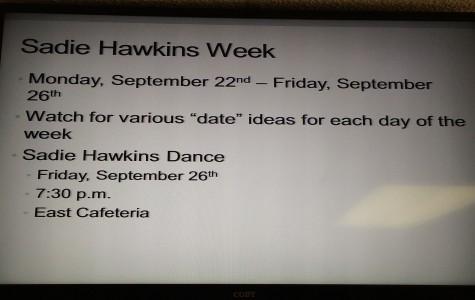 A monitor in the hallway displays information over Sadie Hawkins week.