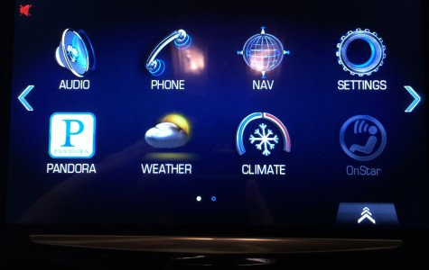 The large touch screen with several applications in a 2014 Cadillac SRX.