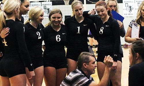 Varsity team gathers during the Sept. 20 home game.
