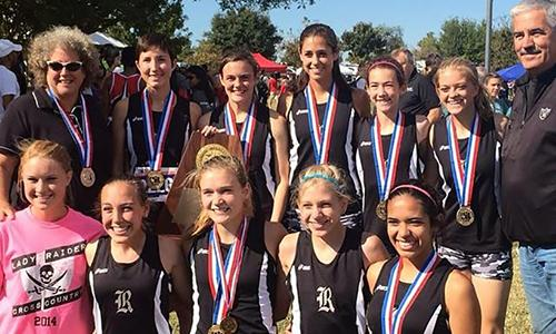 The girls' cross country team are awarded first place metals in Round Rock Saturday.
