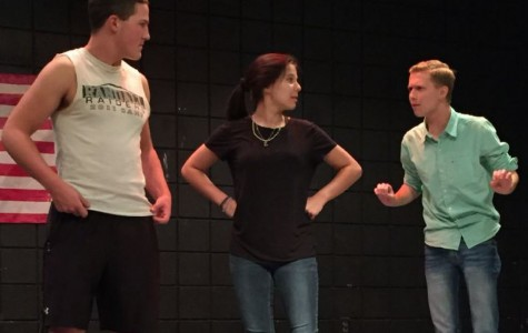 Cutter Pairs, Madee Licky, and Weston Peirce rehears a scene on stage.