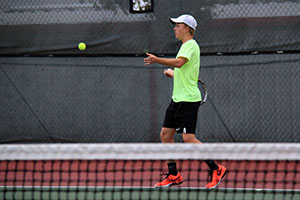 Senior Macauley Webb hits a forehand against Borger on Sept. 17.