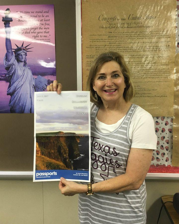Geography+teacher+Mrs.+Weston+holds+a+flyer+for+the+Ireland+trip.