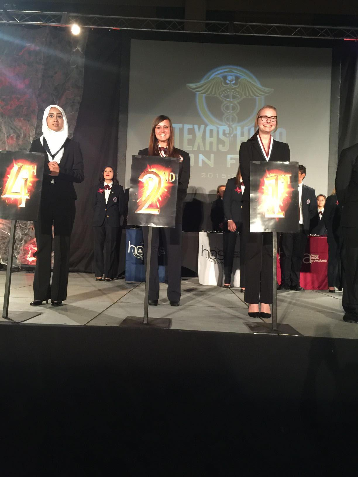 Aubra Platt (middle) poses for a picture at the national HOSA competition.  Photo taken by Jennifer James.