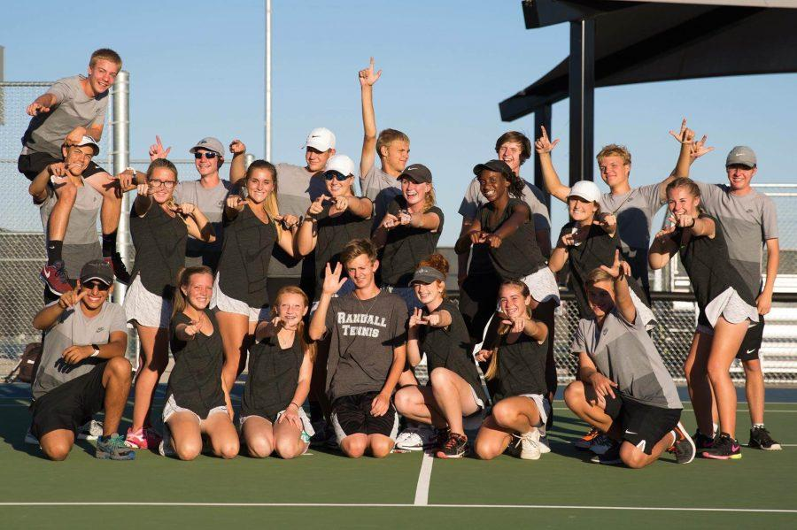 The varsity tennis team celebrates their district title after defeating Palo Duro on Tuesday.