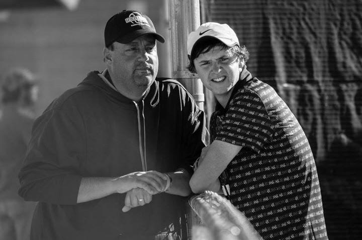 Senior John Stephens and Coach Norman talk during a tennis match this past fall season.
