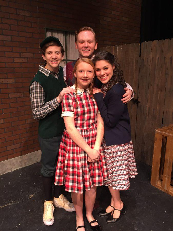 Sophomore Brooklyn Hall poses with some cast members.
