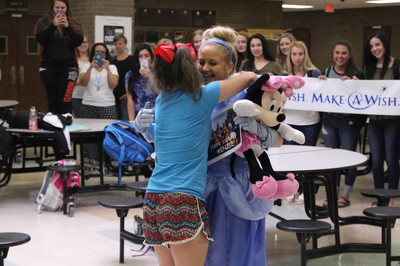 Kenzie Lee embraces Macy Hoyler.
