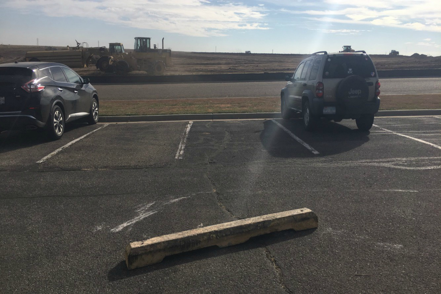 Parking spaces blocked by curb stopper