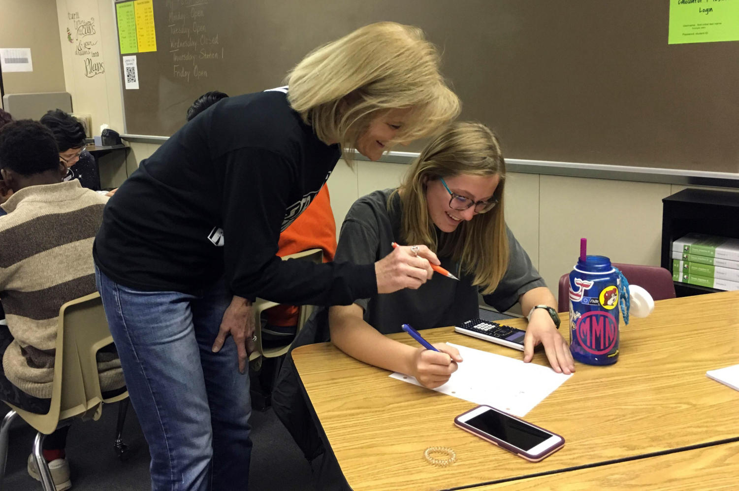 Mrs. Allen (left) helps sophomore Maci Morris (right) with homework during FLEX time.
