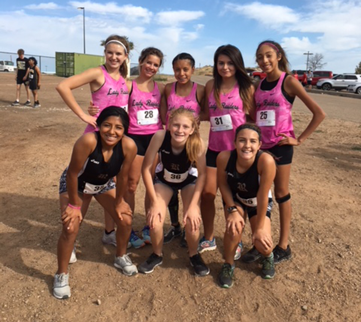 The girls' cross country team gathers after competing in the Borger Meet.