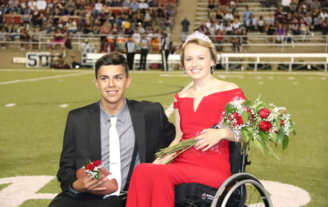 Seniors McKade Barbosa and Kathryn Granger take photos after being crowned Homecoming King and Queen Sept. 14.