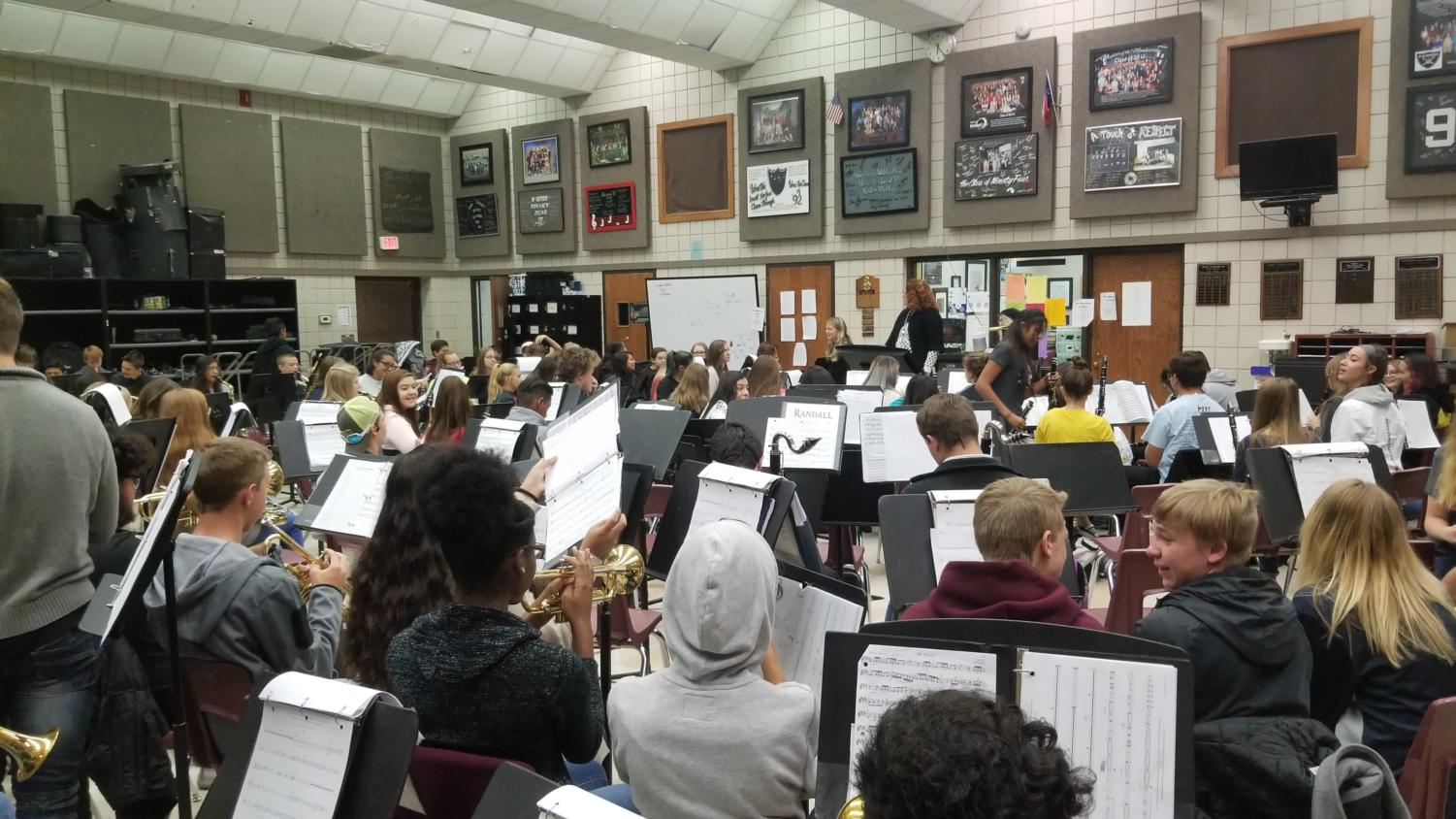 The band practices playing music during their first period band class.