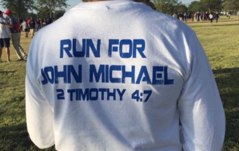 The Randall Cross Country team wears shirts in memory of their former teammate John Michael Morrison.