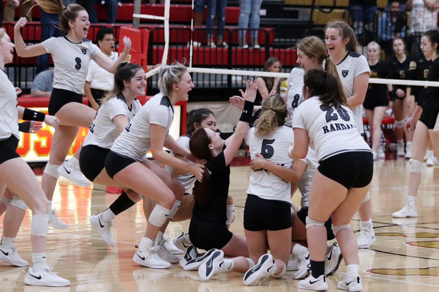 The+Lady+Raiders+celebrate+after+winning+the+regional+tournament+in+Lubbock+Saturday.+The+team+will+compete+for+the+state+title+later+this+week.+