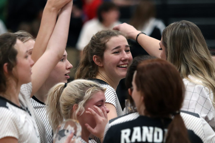 Senior Brianna Ford celebrates with her teammates after the Raiders defeated Amarillo High Nov. 16 to advance to the state tournament.
