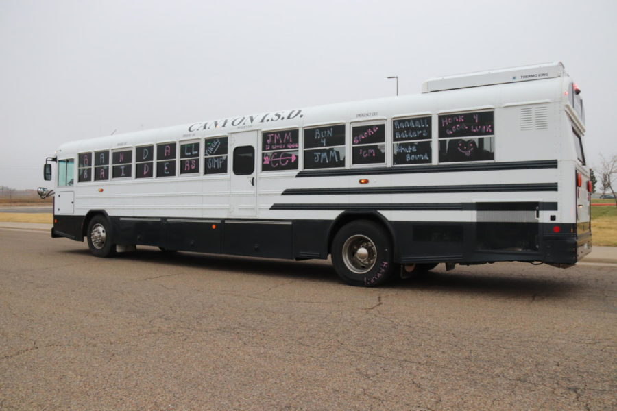 The CISD bus carrying the Randall girls cross country team departs the school on Nov. 7 bound for the state meet.