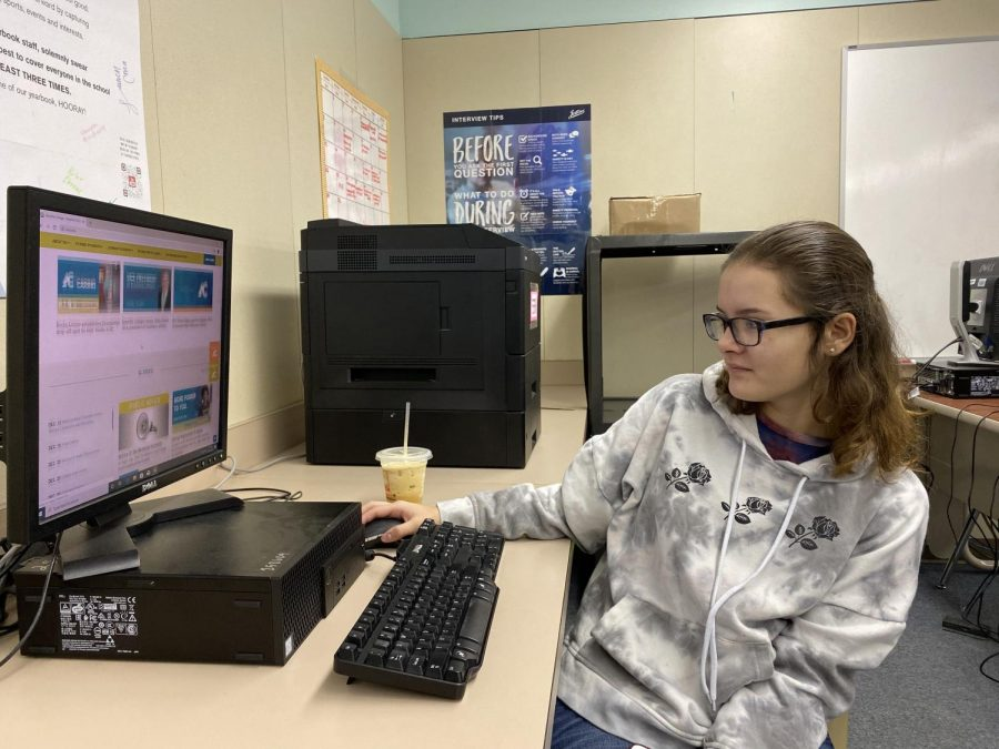 Sophomore Sara Ward, scrolling through Amarillo College