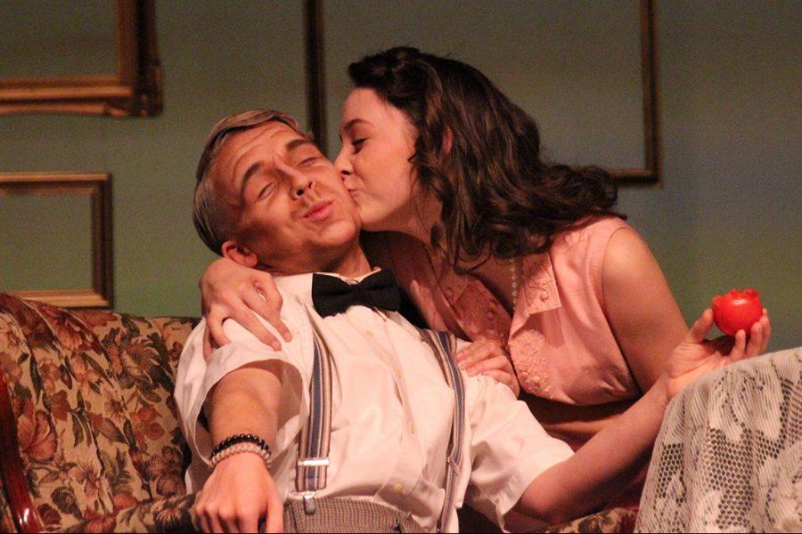 Zapryce Johnson, playing Alice, kisses Kempson White, Grandpa's, cheek as she enters the stage.