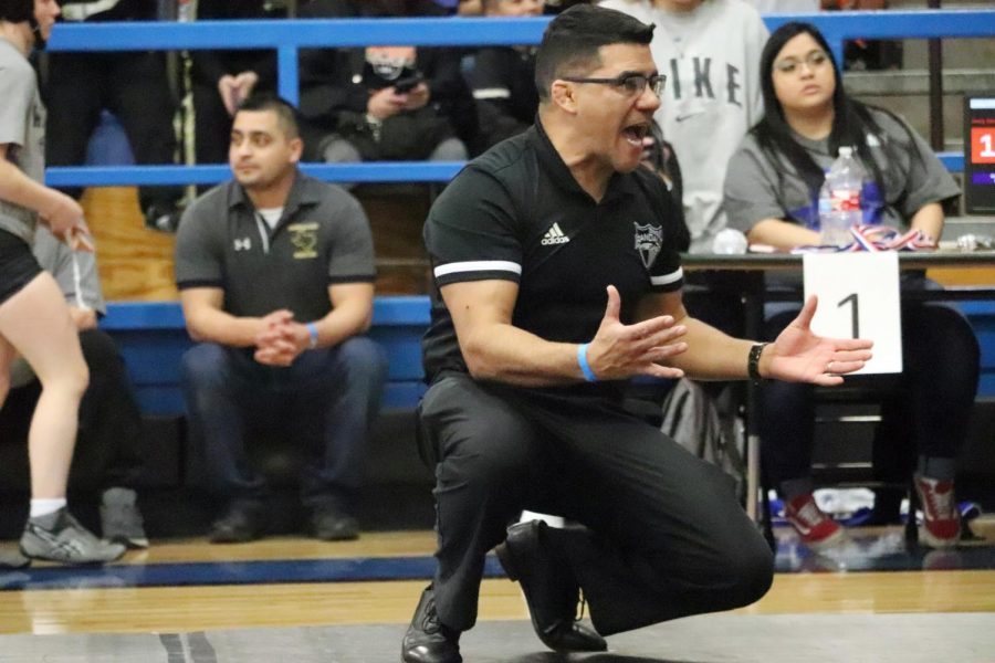 At the district meet, Coach Quirino yells for his athletes.