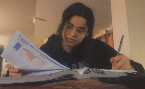 "While taking online classes at home, senior Mariam Alashmawi takes notes for her AP Biology class. This AP class requires a lot of studying and commitment in order to understand the criteria. ""It"