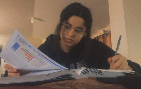 While taking online classes at home, senior Mariam Alashmawi takes notes for her AP Biology class. This AP class requires a lot of studying and commitment in order to understand the criteria.