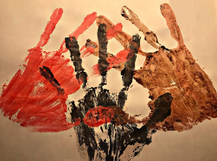 To represent the cultures that are talked about in this series, senior, Mariam Alashmawi painted hand-prints. Red representing Indigenous people, black representing African American people, and brown representing the Latino and Hispanic people.