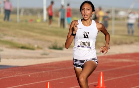Lizzy Chen crosses the finish line during the Oct. 2 meet at Canyon High School.