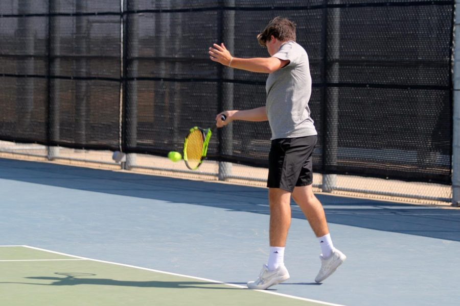 Cutter Mason prevents Lubbock High from scoring during his doubles match.