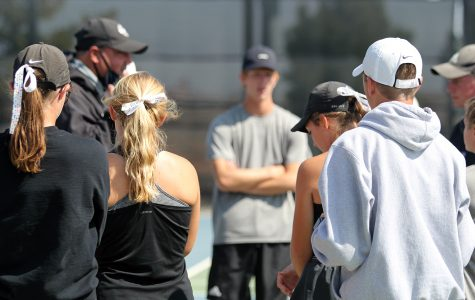 The Randall tennis team huddles around Coach Darby Norman before their match against Lubbock High on Oct. 3.