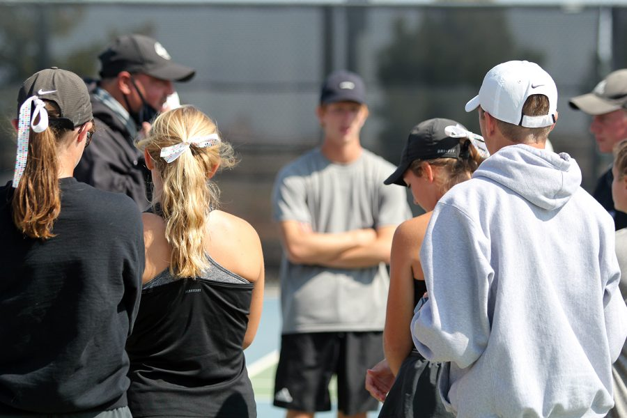 The+Randall+tennis+team+huddles+around+Coach+Darby+Norman+before+their+match+against+Lubbock+High+on+Oct.+3.