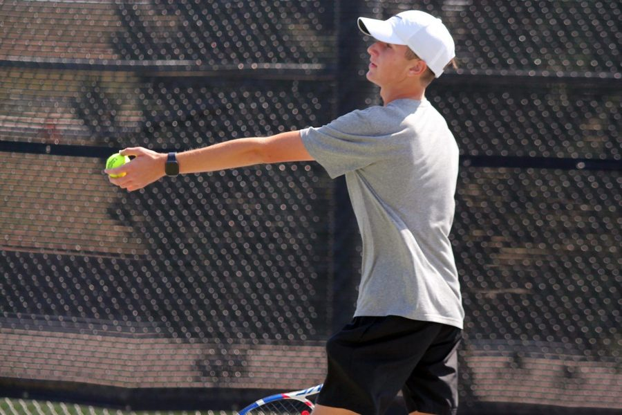 Aiden Gilbert serves the ball during his doubles match Saturday at Randall.
