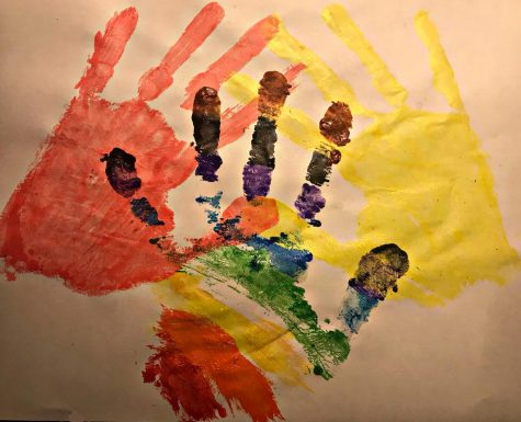 To represent the cultures that are talked about in this series, senior, Mariam Alashmawi painted hand-prints. Pink representing Southeast Asian people, the rainbow representing LGBTQ+ people, and yellow representing disabled people.