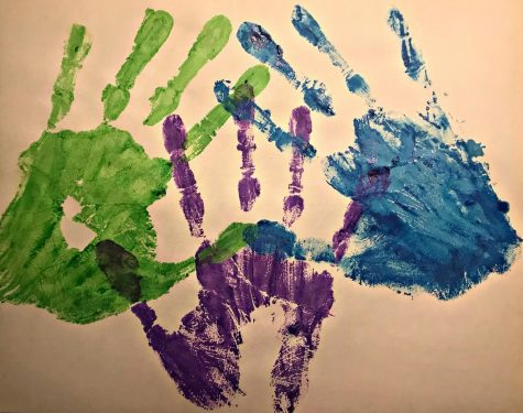 To represent the cultures that are talked about in this series, senior, Mariam Alashmawi painted hand-prints. Green representing Asian people, purple representing Middle Eastern people, and blue representing the Pacific Islander people.