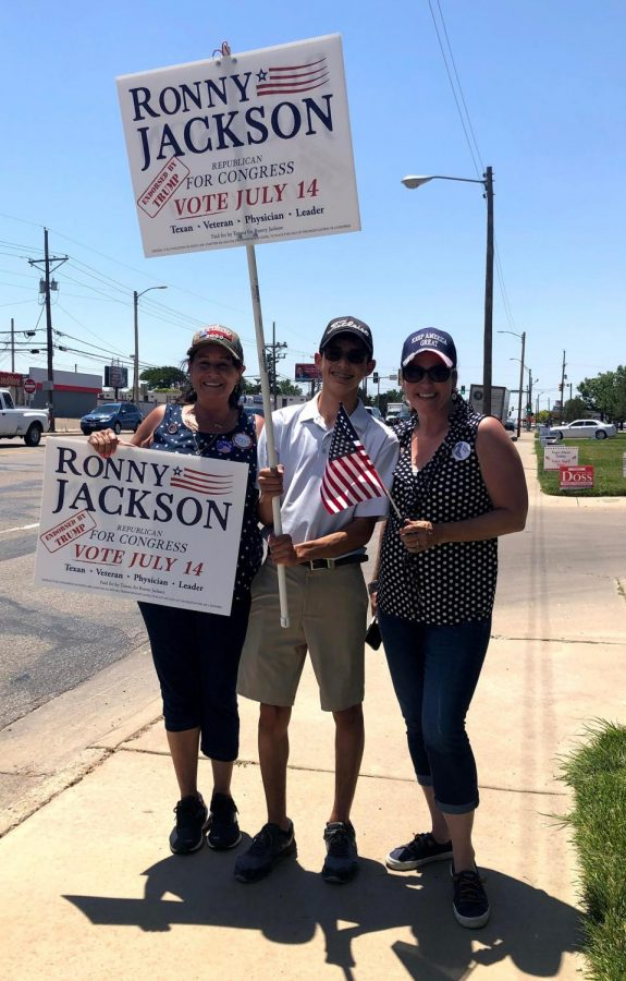 Sophomore Adrian Avila campaigns with other Jackson supporters on the streets of Amarillo.