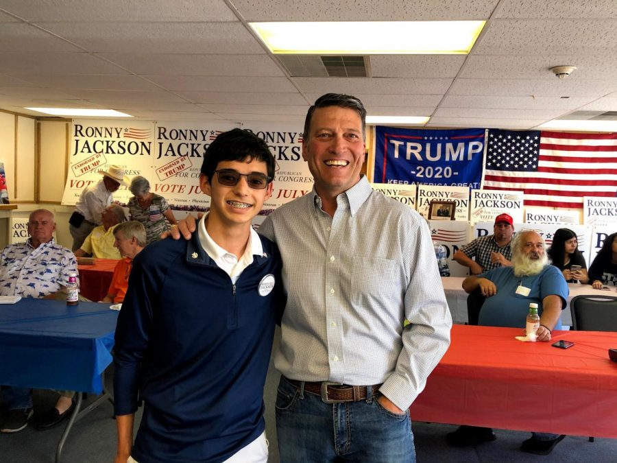 Sophomore+Adrian+Avila+stands+with+Congressional+Candidate+Ronny+Jackson+at+Jackson%27s+campaign+headquarters.+