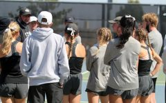 The tennis team gathers on their home court before a match against Lubbock High.
