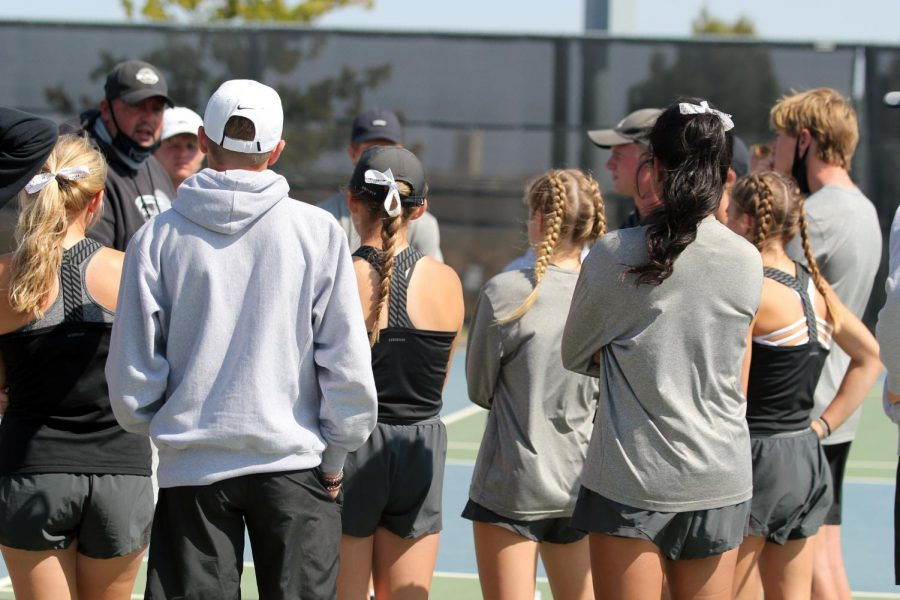 The+tennis+team+gathers+on+their+home+court+before+a+match+against+Lubbock+High.+