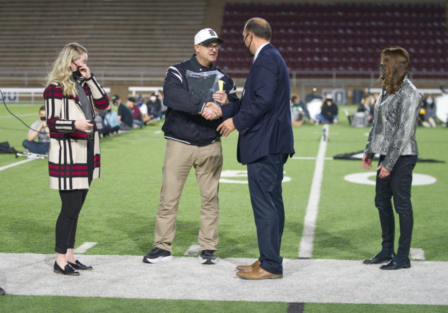 Principal Steven Singleton welcomes Jeff Schwartzenberg into the Raider Hall of Fame during half-time of the Nov. 13 homecoming game.
