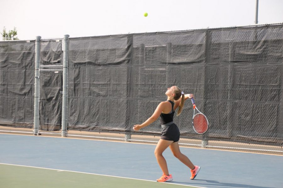 Sophomore Landry Posey serves during a home match against Lubbock High.