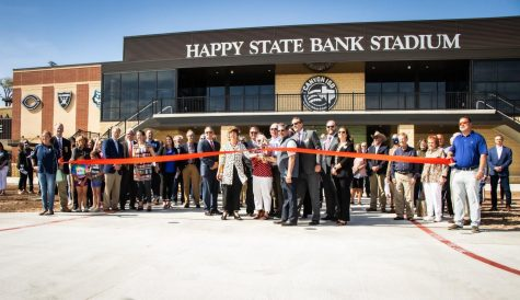 Members from Canyon Independent School District and Happy State Bank held a ribbon-cutting ceremony to open the Happy State Bank Stadium.