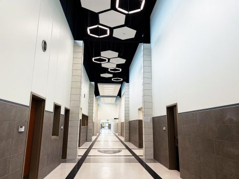 When you walk into the school and look up you see high ceilings with hexagon shaped lights. The hallways look a lot nicer and clean.