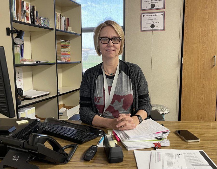 Renee Sprinkle working at her desk in her classroom.